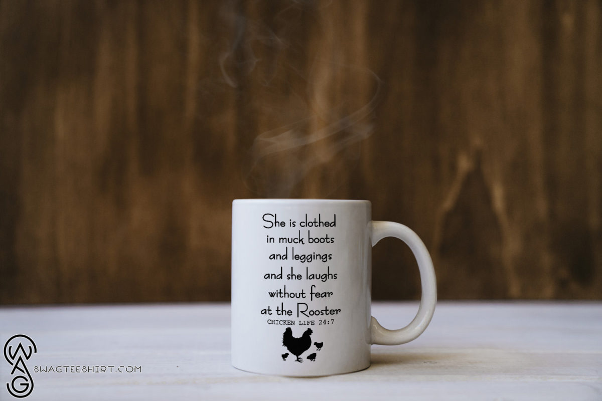 She is clothed in much boots and leggings and she laughs without fear at the rooster mug