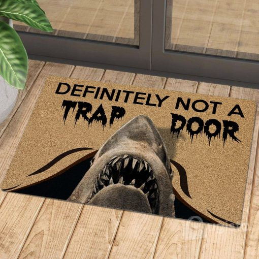 definitely not a trap door shark cat doormat 1