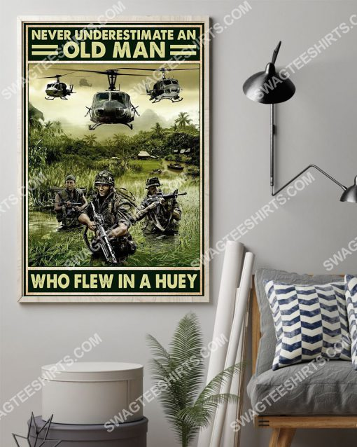vintage never underestimate an old man who flew in a huey poster 2(1)